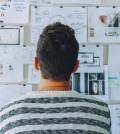 man looking at bulletin board